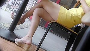 Crossed legs asian feet in wedge sandals